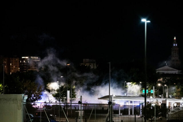 Night time view of smoke over protest site.