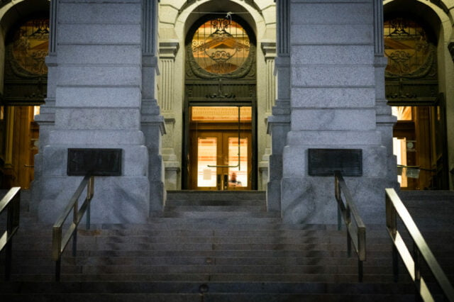 Night time view of the front door of the Denver capitol and stairs.