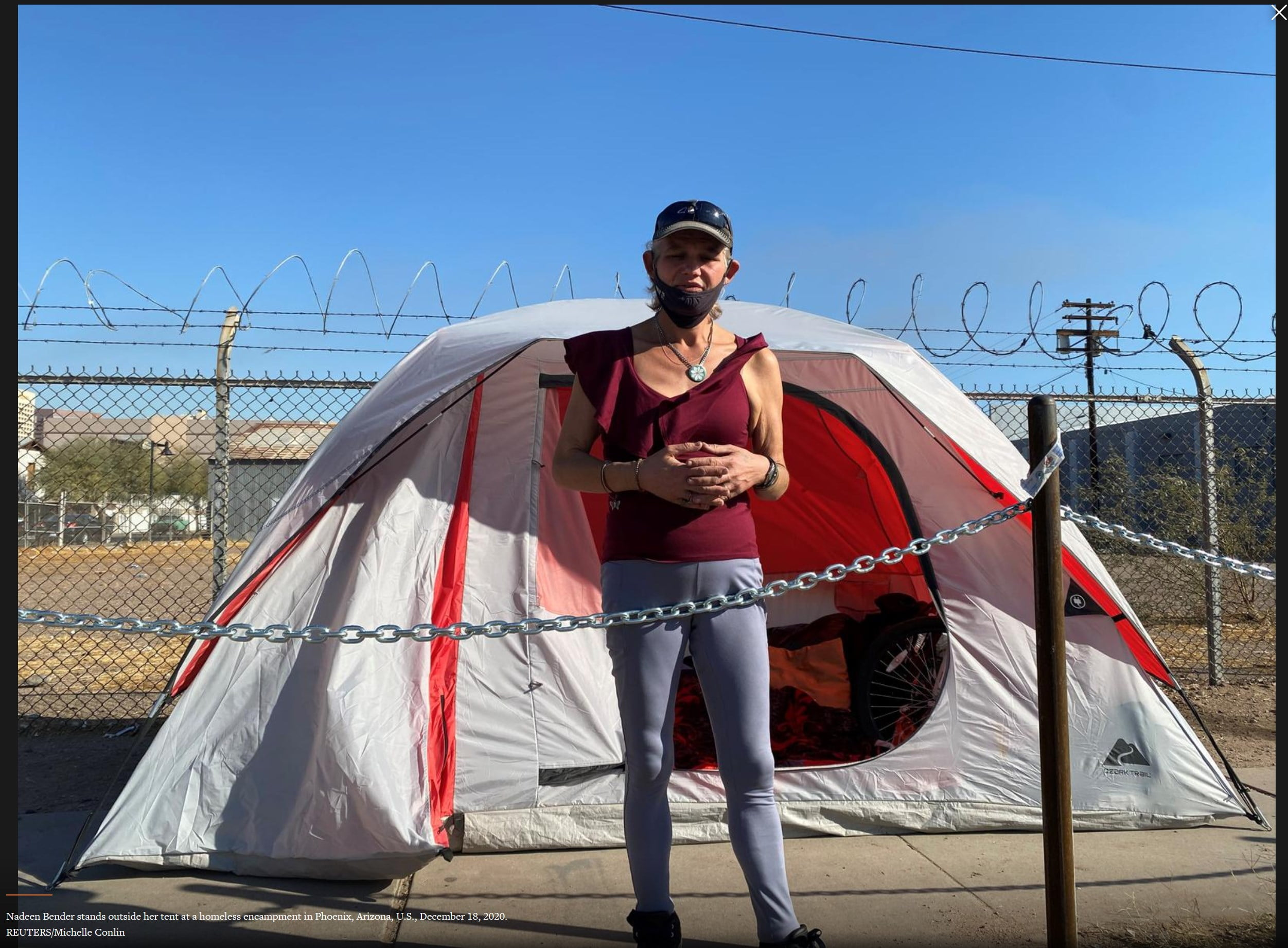 Photo of woman in front of tent