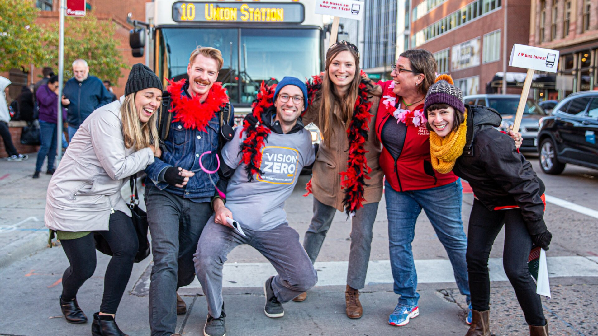 Denver Streets Partnership advocates in front of the RTD 10 bus