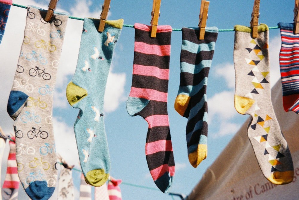 Stock photo of mismatched socks hanging on a clothesline